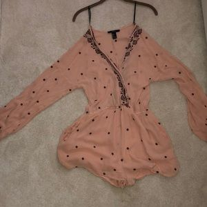 A beautiful light pink romper with maroon roses!